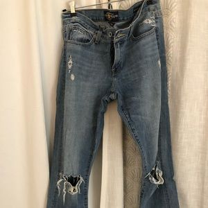 Mid-rise, ripped jeans